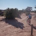 Cutting back toward the parking area.- Good Water Rim Mountain Bike Trail