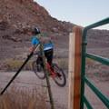 Climbing past gate onto Jurassic.- Klondike Bluffs Mountain Bike Trails: Jurassic to Dino Flow
