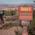 Turning past the trailhead onto Rockin' A.- MOAB Brand Trails: Rockin' A