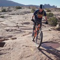 Flying past the trailmarker at the top of the loop.- MOAB Brand Trails: Rockin' A