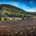 Panorama of Big Cinder Butte and surrounding terrain. Big Cinder Butte is the highest volcanic feature in Craters of the Moon National Monument and Preserve.- Craters of the Moon National Monument and Preserve