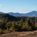 Whiteface Mountain rises in the distance.- Jay Mountain Hike
