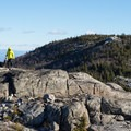 Hikers take in the 360-views at the summit of Jay Mountain.- Jay Mountain Hike