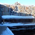There are benches by the pool that are handy on less snowy days.- Hart Mountain Hot Springs