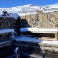 A ladder leads down into the crystal clear soaking pool.- Hart Mountain Hot Springs