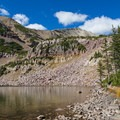 Morat Lake and Mount Aggassiz. The trail continues up the slope on the right of the photo.- Naturalist Basin Hike
