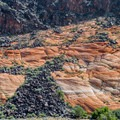 Volcanic rocks strewn over the hillsides, Upper Galoot Picnic Area.- Snow Canyon State Park