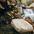The rock that has not been sculpted by the water is jagged and sharp.- Honey Hollow Falls