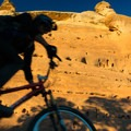 Giant red rock walls tower over the trail's end.- Kokopelli Loops Mountain Bike Trails: Rustler's Loop