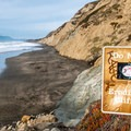 In spite of this sign, the foot paths show a lot of people using this way to the beach.- Mussel Rock Area