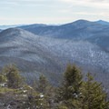 Looking south from the summit with Camel's Hump in the distance.- Maple Ridge + Butler Lodge Loop