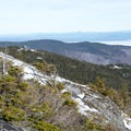 Looking back at Stowe Mountain Resort from the Long Trail.- Maple Ridge + Butler Lodge Loop