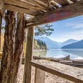 Looking out at Lillooet Lake from inside a driftwood hut at Strawberry Point.- Lillooet Lake Campgrounds