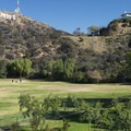 Lake Hollywood Park with view of Hollywood Sign on Mount Lee.- Lake Hollywood Park