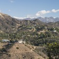 View of the Hollywood Sign atop Mount Lee with the San Gabriel Mountains.- Mulholland Drive, Jerome Daniel Overlook