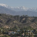 View of Griffith Observatory and Mount Baldy (10,064 ft) from Runyon Canyon Park.- Runyon Canyon Park