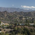 View east to Griffith Park and the San Gabriel Mountains with Mount Baldy (10,064 ft) in the distance.- Runyon Canyon Road Hike