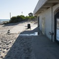 Restroom and outdoor shower facilities at Surfrider Beach and Malibu Lagoon State Beach.- Malibu Lagoon State Beach + Surfrider Beach