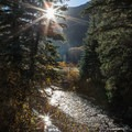 Sun and reflection over the San Miguel River.- Bear Creek Falls Hike
