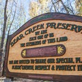 "The welcome sign to the Bear Creek Preserve reads, ""We are each one of us the stewards of this land.""- Bear Creek Falls Hike"