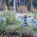 Rock cairns in a meadow about half way up the trail.- Bear Creek Falls Hike