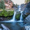 Moss-covered rocks at the base on Bear Creek Falls.- Bear Creek Falls Hike