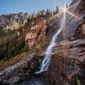 The sun rises over Bear Creek Falls very late in the morning in fall.- Bear Creek Falls Hike