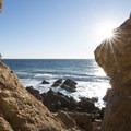 Rocky shore adjacent to Westward Beach at Point Dume State Beach.- Point Dume State Beach