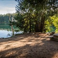 A lakefront campsite at Cat Lake.- Cat Lake Campground