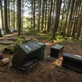 Garbage bins and bear-proof food storage containers.- Cat Lake Campground
