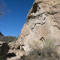Rock climbers on Planet of the Apes Wall.- Rock Pool Swimming Hole