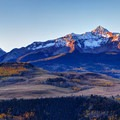 Sunrise with a view of Wilson Peak (14,252 ft.), Lizard Head, and other peaks from Last Dollar Road.- Last Dollar Road