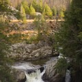 The top of the falls with the road in the background.- Big Falls State Park