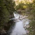 Looking downstream at a swimming hole.- Big Falls State Park