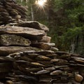 People have stacked the flat rocks from the riverbed into interesting structures.- Big Falls State Park