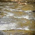 A few riffles below the swimming hole in Big Falls State Park.- Big Falls State Park