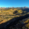 Aerial view of the road, Sneffels Range, and yellow aspen about to lose their leaves.- Dallas Divide Scenic Route