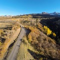 West Dallas Road winds through aspen groves.- Dallas Divide Scenic Route