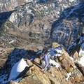 Working around some early snow on a steep fourth-class section.- Mount Superior
