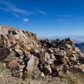 Rock shelter and summit register on Deseret Peak.- Deseret Peak Hike