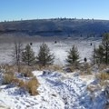 Snow covers the steep path that plunges down the hillside and into the crater.- Hole-in-the-Ground