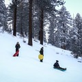The upper slope is steeper and good for more daring sledders.- Spooner Summit Sledding