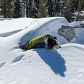 Deep snow can cover gaps between boulders.- Loch Leven Lakes Snowshoe