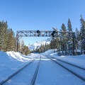 Crossing the Union Pacific Railroad line to access the trail.- Loch Leven Lakes Snowshoe