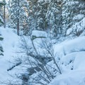 Snow covered creek that runs beside the trail.- Loch Leven Lakes Snowshoe