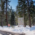 Entrance to the 1960 Winter Olympic Biathlon.- Blue Trail Snowshoe in Sugar Pine Point State Park