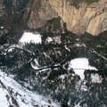 Peaking over the edge toward Curry Village, Yosemite Village and the Ahwahnee Hotel.- Glacier Point Cross-Country Ski