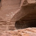 Kokopelli Cave paintings in Canyon De Chelly National Monument.- Canyon De Chelly National Monument