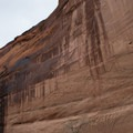The proportions of the towering cliffs are difficult to convey.- Canyon De Chelly National Monument