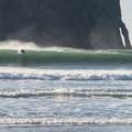 Surfer at Pacific City, Oregon.- Pacific City
